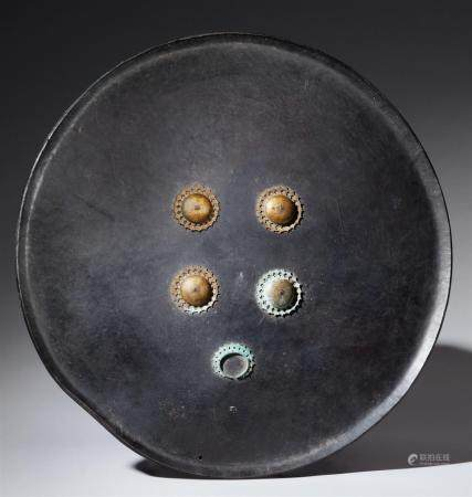 A large Indian round lacquered leather shield (dhal). 19th century