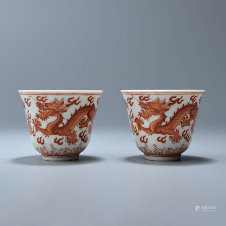 PAIR OF IRON RED DRAGON TEACUPS, XUANTONG MARK