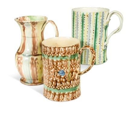 An 18th century Whieldon type mask jug,