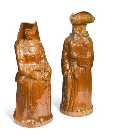 A rare pair of Doulton Lambeth salt glazed figural jugs,