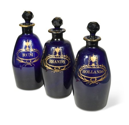 A set of three Bristol Blue decanters and stoppers,