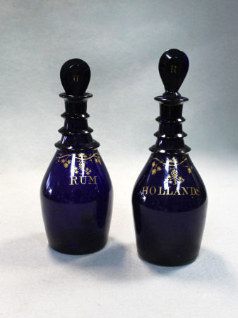 A pair of 19th century Bristol Blue triple neck decanters and stoppers,