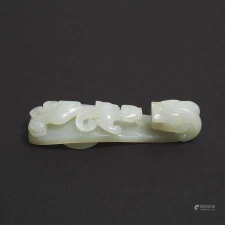 A Mottled White Jade Belt Hook, Qing Dynasty, 清 白玉雕苍龙教子带钩, length 3.7 in — 9.5 cm