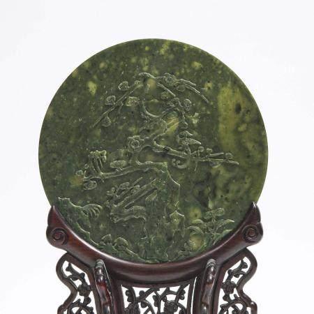 A Spinach-Green Jade 'Phoenix and Plum Blossom' Table Screen, 碧玉雕'凤梅图'圆插屏, diameter 8.7 in — 22.2 cm