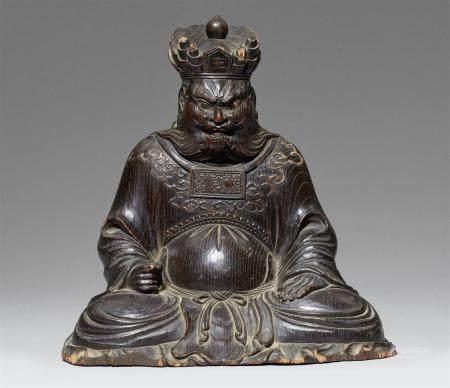 Une figure en bois noirci d'un roi de l'enfer (Enma-o). Période Meiji, fin du XIXe siècle Meiji