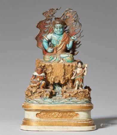 Une petite figure de Fudô Myôô et d'acolytes. Fin du XIXe siècle  Le dieu à la peau bleue tenan