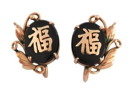 A pair of Chinese themed earrings