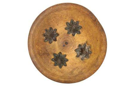 A Wood and Dried Leather Ceremonial Shield