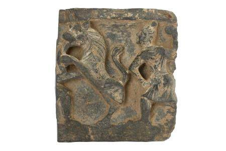 A Grey Schist Carved Fragment with a Rampant Lion