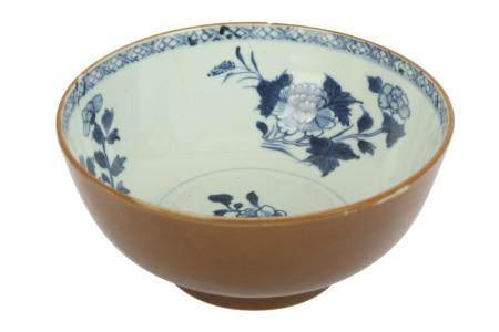 An 18th century Chinese Nanking cargo blue and white and cafe-au-lait porcelain bowl,