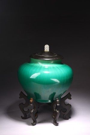 A GREEN GLAZED JAR WITH COVER
