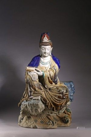 A LARGE CHINESE POLYCHROME GLAZED SEATED FIGURE OF GUANYIN