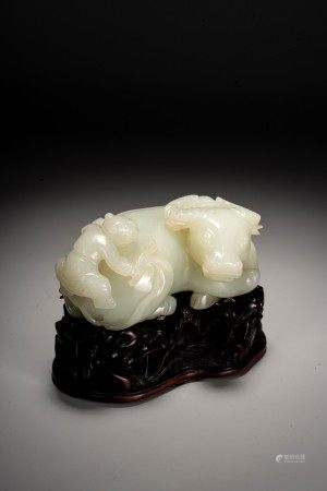 A CHINESE WHITE JADE CARVED BUFFALO AND BOY