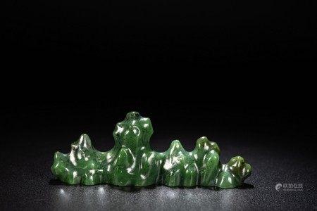 A CHINESE SPINACH GREEN JADE 'ROCKWORK' BRUSHREST