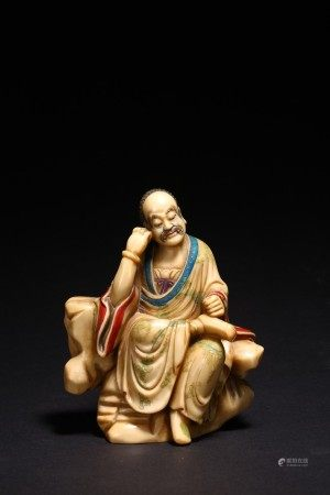 A CHINESE SHOUSHAN STONE LUOHAN FIGURE