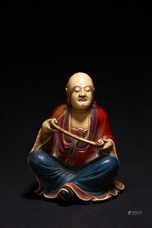 A CHINESE SHOUSHAN STONE PAINTED ARHAT FIGURE