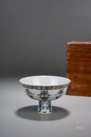 A DOUCAI 'BUDDHIST SYMBOLS' STEM CUP
