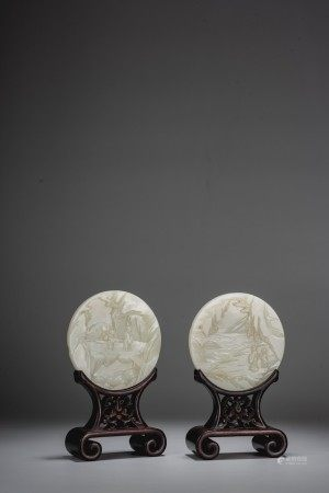 A PAIR OF SMALL WHITE JADE CIRCULAR PLAQUES