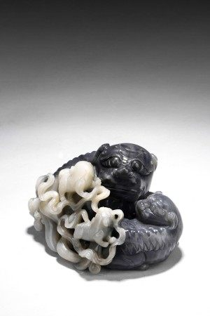 A LARGE BLACK AND WHITE JADE 'MYTHICAL BEASTS' GROUP