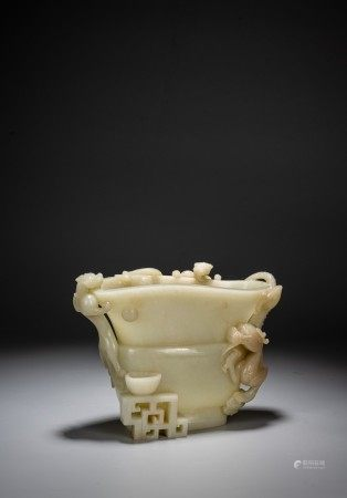 A WHITE JADE CARVED ARCHAISTIC 'DRAGON' CUP, GUANG
