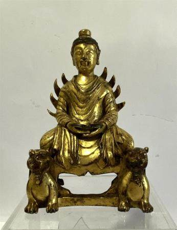 A Gilt Bronze Metal Alloy of a Seated Bodhisattva on a Rectangular Base Flanked by Tigers, 20th C.,