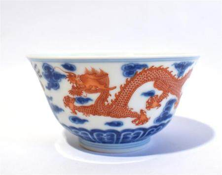 A Porcelain Blue & White Bowl with a SLightly Everted Rim Iron Red Dragon Snaking His Way Around the Clouds, Jiaqing Seal Mark to th...