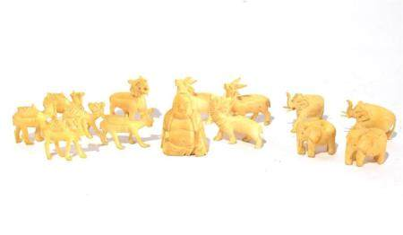 Fourteen Small Ivory Carvings, including Camels & Elephants. mid 20th C.,