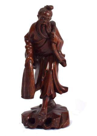 A Deftly Carved Chinese Wood Figure, with Inlaid Eyes,
