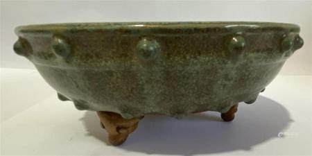 A Celadon Glazed Narcissus Bowl the Rim Bordered by Evenly Spaced Studs, Supported on Three Ruyi-Shaped Feet,