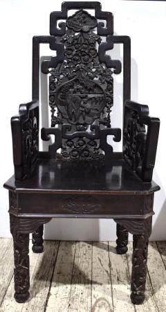 A Dark Hardwood Chair with a High Back