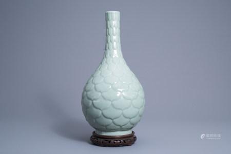 A Chinese monochrome celadon vase with underglaze relief design, Qianlong mark, 19th C.