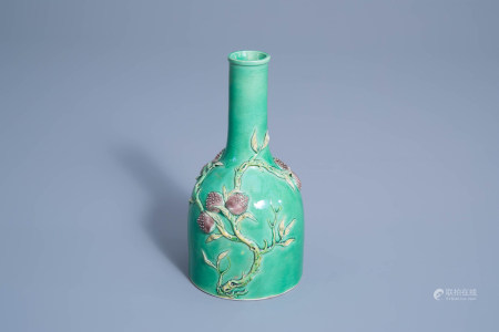 A Chinese verte biscuit vase with relief design of nine peaches, 19th/20th C.