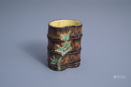A Chinese polychrome bamboo shaped brush pot, Qianlong mark, 20th C.