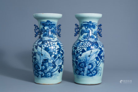 A pair of Chinese blue and white celadon vases with cranes on a rock, 19th C.