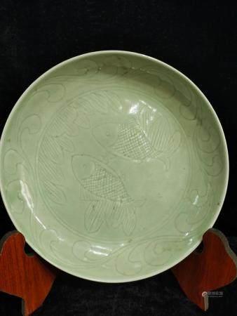 a chinese celadon dish guan xu mark
