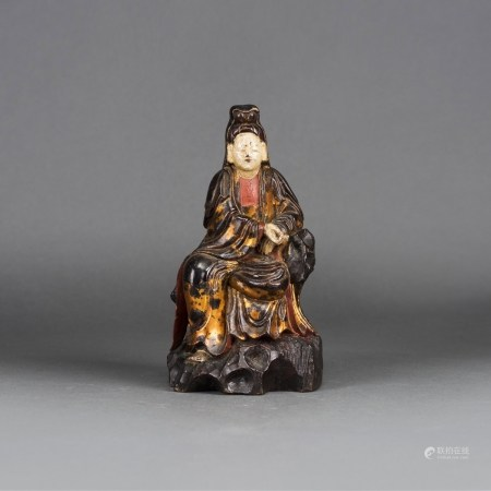 A CHINESE LACQUERED FIGURE OF GUANYIN