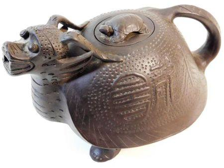 A large Chinese Yixing style dragon teapot 11in wi