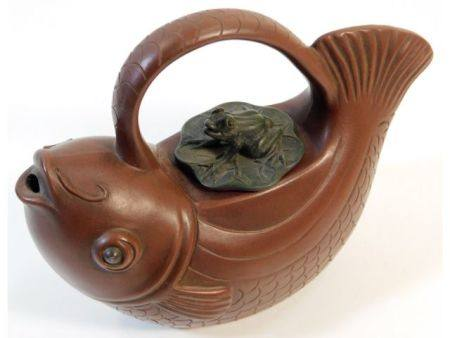 A Chinese Yixing teapot depicting carp with lily p