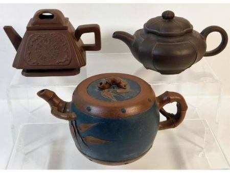 Three small Chinese Yixing teapots, largest 6.5in