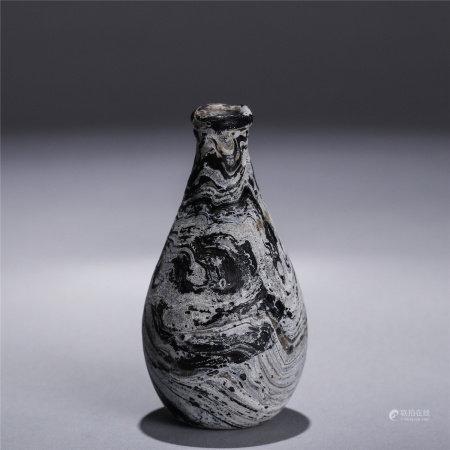 A purple glassware vase