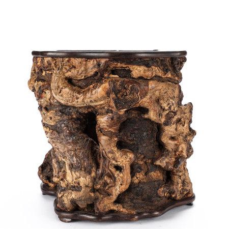 A wooden brush pot