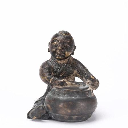A copper figure ornament