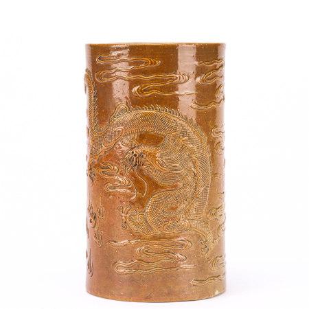 A glazed dragon carved porcelain brush pot