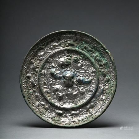 A Tang Dynasty Sea Beasts with Grapes Bronze Mirror