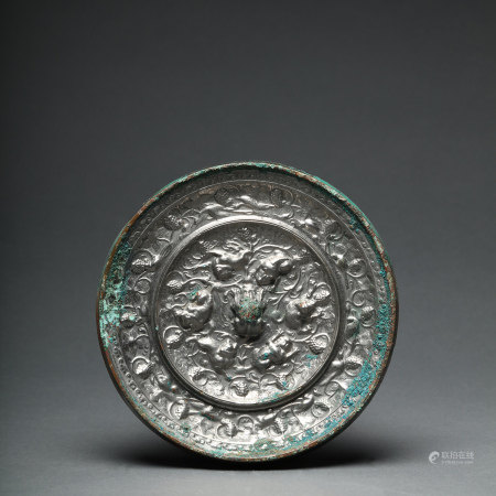 An Auspicious Beasts and Grapes Bronze Mirror Tang Dynasty