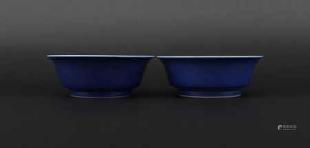A pair of blue glazed cup