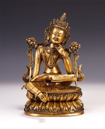 A CHINESE GILT BRONZE MANJUSRI SEATED STATUE