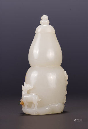 A CHINESE WHITE JADE GOURD LIDDED BOTTLE
