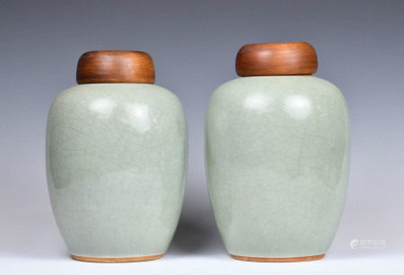 A Pair of Pea-green Glazed Jars and Wood Covers, 1