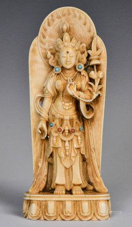 A Bone Carved Germstone Insert Guanyin